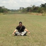 Jose Antonio sitting on a grass runway.